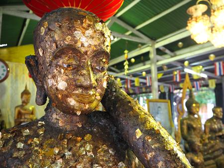 thai buddha: Golden head of meditating Buddha inside Thai temple