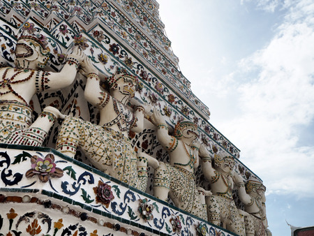 Thai art wall around Wat Arun Rajwararam. Bangkok Stock Photo
