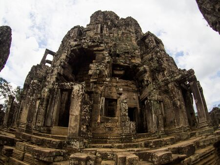 prasat bayon: Enigmatic giant stone faces of ancient Bayon temple in Angkor Thom, Siem Reap, Cambodia.
