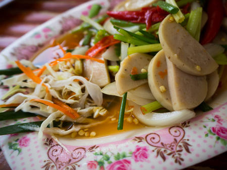 moo: Thai cuisine spicy pork salad or Yum Moo Yor.