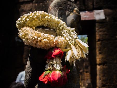 Sandstone statue of god Khmer Art at Prasat Muang Singh in Kanjanaburi , Thailand. Stock Photo