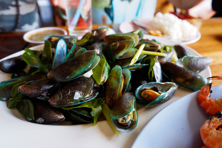 Boiled mussels with spicy seafood sauce.