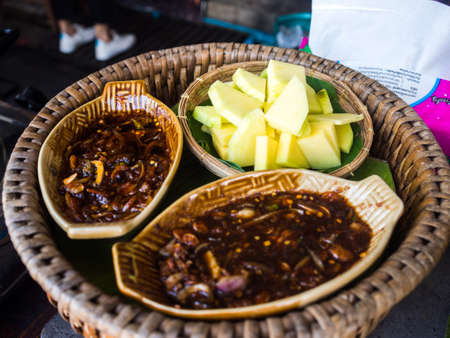 Green Mangoes with Sweet fish sauce, Thai food. Stock Photo