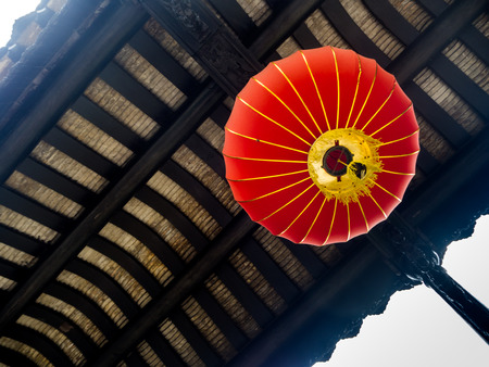 Typical red Chinese lantern hanging outside, Guangzhou, China.