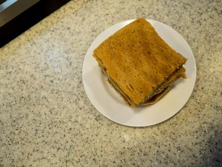 Singapore Breakfast called Kaya Toast, Coffee bread and Half boiled eggs.