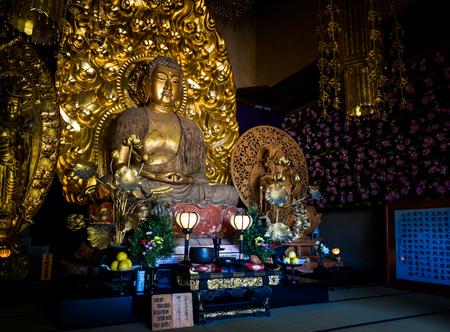 Gold buddha statue of Hase-dera temple in Kamakura, Japan - Sep, 2018. Standard-Bild - 120301345