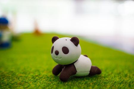 Cute little Panda : small figurines of animals, stone figure statue, object macro , toy animals.