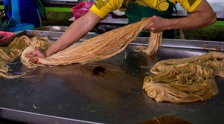 How to cook Roti Saimai or Thai cotton candy burrito pancake.