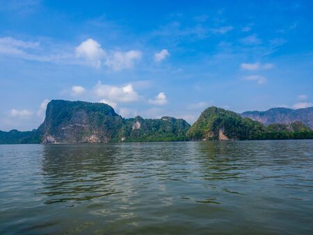Longtail boat Tour among the scenic limestone islands in Phang Nga Bay. Thailand