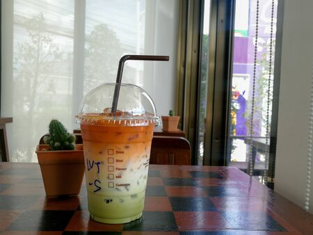 Thai milk tea mix with Green tea Cold drink on a table.