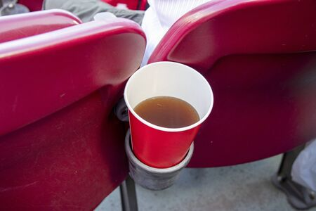 Drink holder on a baseball stadium chair