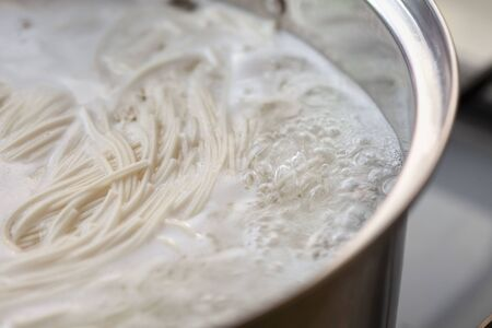 Japanese traditional noodles, somen boiled in a pot