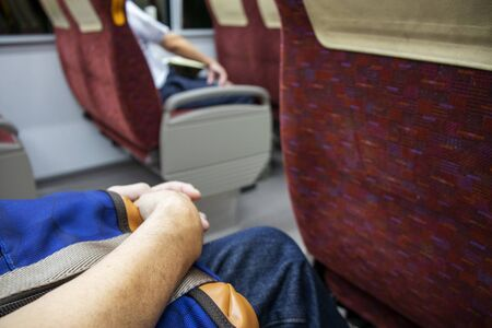 Male hand sitting on train chair