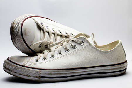 Dirty and worn-out sneakers for years
