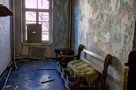 industrial wasteland: abandonned and brocken couch