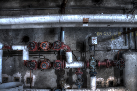 industrial wasteland: heater pipes in barrack basement