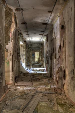 hostel corridor with fallen paper photo