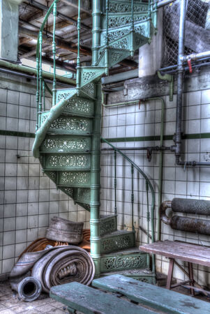 infiltration: green spiral staircase at the abandoned mine