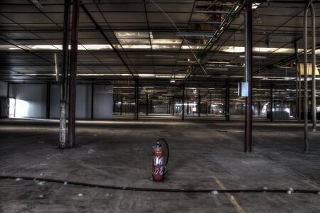 industrial wasteland: abandoned red extinguisher