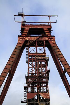 industrial wasteland: red headframe Sainte Fontaine Moselle France Stock Photo
