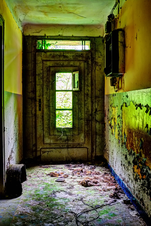old door with wood in an abandonned house