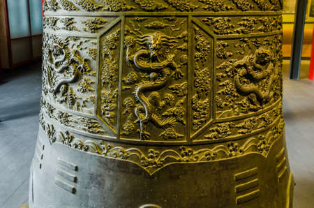 folk heritage: Close up of the ancient bell in the Big Bell Temple Editorial