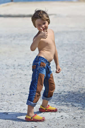 unclothed: 6-year-old boy in jeans showing gesture ok