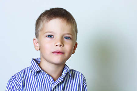 6 year old: Calm portrait of 6 year old boy in a striped shirt