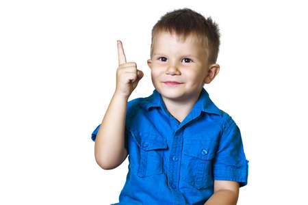 gesticulating: Funny boy points finger on a white background. Humor, emotion, gestures.