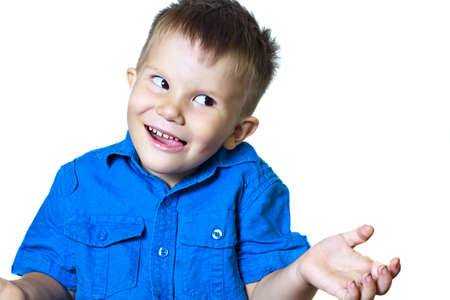 gesticulating: Funny gesticulating 3-year-old boy in a blue shirt on a white background Stock Photo