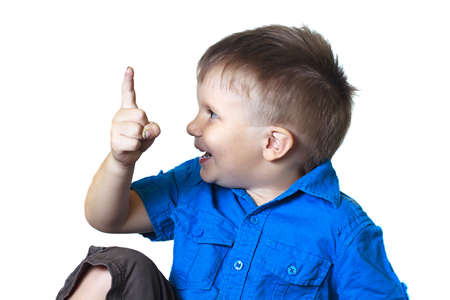 gesticulating: Funny boy points finger on a white background. Humor, emotions, gesture.