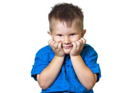 he old: Fun-loving 3 year old boy pretends he thinks on a white background. Gestures and facial expressions. Stock Photo