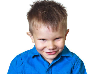 gesticulating: Playful smiling boy on a white background. Smiles, emotions, grimacing.