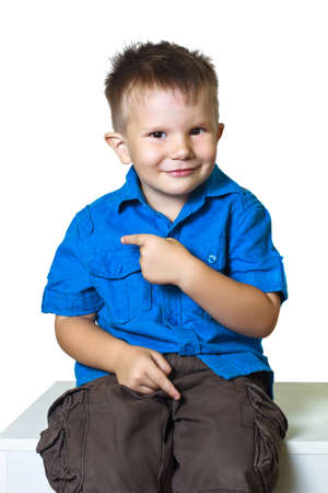 gesticulating: Funny giggly boy gesticulating on a white background