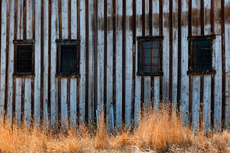 Steel bars cover windows on an old abandoned building.