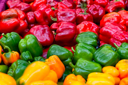 Close up of red, green and yellow bell peppers at a farmers market Stock fotó