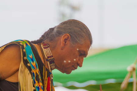 Portland, Oregon USA - June 14, 2014: Native American preparing for a dance at Delta Parks annual Pow Wow in Portland, Oregon Editorial