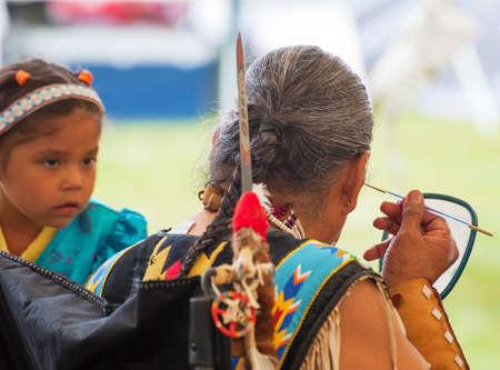 Portland, Oregon, USA - June, 14, 2014: Native American preparing for a dance at Delta Parks annual Pow Wow in Portland, Oregon