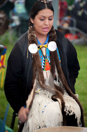 Portland, Oregon USA - June 14, 2014:  Native American female drummer at the annual Delta Park Pow Wow in Portland, Oregon Editorial