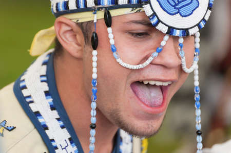 Portland, Oregon, USA - June, 14, 2014: Closeup of Native American chanting during a pow wow.