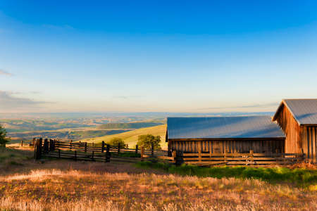 Dawns Light view of out buildings and vast landscape of The Dallas Mountain Ranch