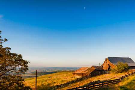 Dawns Light view of out buildings and vast landscape of The Dallas Mountain Ranch, a popular hiking and picture taking place that is part of the Columbia Hills Natural Preserve and State park in the state of Washington in the Columbia River Gorge. Stock Photo