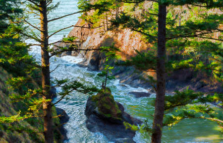 Looking down at a little cove along the coastal shoreline at Cape Disappointment in Iwaco, Washington