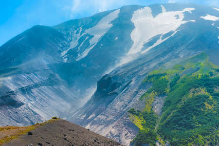 Mt. St. Helens heart shaped glacier looms above a vast carved out section of the side of the volcano.