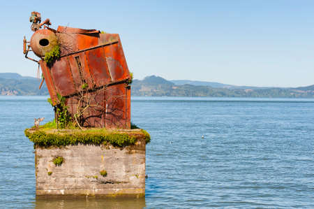 Large rusted out boiler is the remnant of White Star Cannery that was destroyed by fire over 50 years ago in Astoria, Oregon.