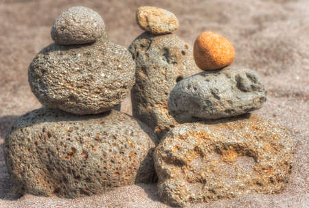 At Oxbow Park, alongd the Sandy River, has a beach where rocks are staked by anyone who visits the area creating a village of stacked rocks.