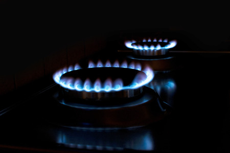 stove fire: gas stove with blue fire Stock Photo