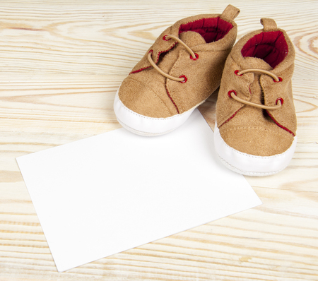pair of baby shoes on wooden table
