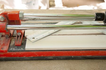 tile cutter: cutting ceramic tiles with a tile cutter Stock Photo
