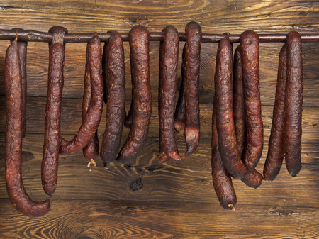 fatness: kind of sausage - wooden background Stock Photo